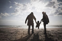 Family on Beach in Winter,Lazio,Rome,Italy