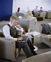 Businessman Using Laptop in Lounge