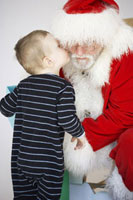 Boy Giving Santa a Kiss