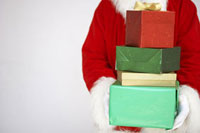 Santa Holding Stack of Presents