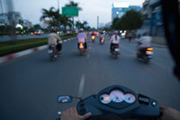 Motorcyclist Driving through Ho Chi Minh City�CVietnam