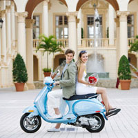 Couple sitting on a moped,Biltmore Hotel