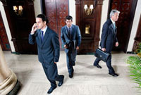 Three businessmen walking in a hotel lobby,Biltmore Hotel