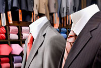 Close-up of mannequins with formal suits in a clothing store