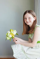 Portrait of Girl Wearing Easter Dress Holding Flowers