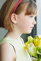 Girl Wearing Easter Dress Holding Flowers