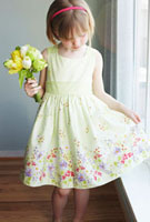 Girl Wearing Easter Dress Holding Flowers