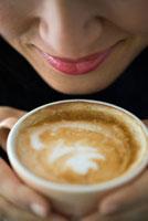 Woman Enjoying Cappuccino