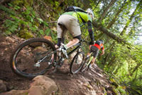 Man and Woman Mountain Biking on the Post Canyon Trail Near