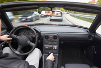 Man Driving Mazda Miata
