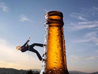 Businesswoman Climbing up Beer Bottle