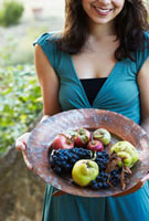 Woman Holding Plate of Fruit