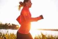 Woman Running in Green Lake Park, Seattle, Washington, USA