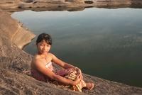 Girl Sitting by Pond at SamPanBok, UbonRatchathani Province,