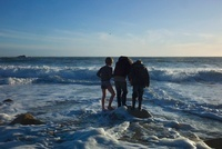 Three Boys Standing on Rock at Beach inWinter, Quiberon, Gul