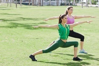 Two Women Doing Yoga in the Park