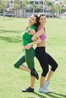 Two Women Exercising in Park