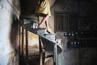 Woman Walking Down Old Staircase