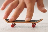 Boy's Hand with Toy Skateboard
