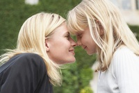 Mother and Daughter Rubbing Noses