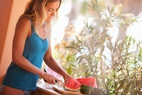 Woman Slicing Watermelon, Near Cabo Pulmo, Baja California S