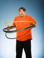 Man With Hula Hoops Looking Confused