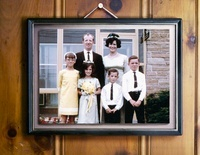 Vintage 1960s Family Portrait Hanging on Wood Panelled Wall