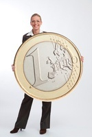 Businesswoman Holding Large Euro Coin