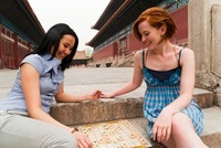 Women Playing Chinese Chess in front ofHall for Worship Of A