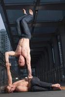 Two Acrobats Performing Outside, Taipa,Macau, China