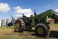 Farmer Driving Tractor, outside Saltcoats, Saskatchewan, Can