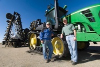 Father and Son Farmers in front of New Tractor and Air Seede