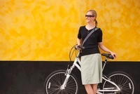 Woman with Cruiser Bike Leaning AgainstWall