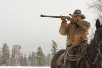 Cowboy Aiming Shotgun, Triple D Game Farm, Whitefish, Montan