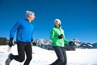 Couple Running Outdoors in Winter
