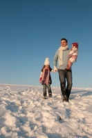 Man with Daughters Outdoors in Winter