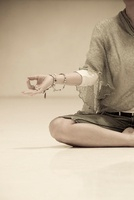 Woman Meditating with Prayer Beads