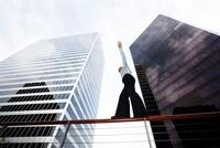 Businesswoman Balacing on Railing