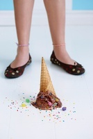 Dropped Chocolate Ice Cream Cone UpsideDown on Floor at Girl