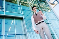 Businessman with Cell Phone Outside of Office Building
