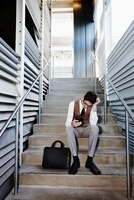 Frustrated Businessman Sitting on Stairs