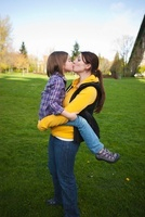 Mother and Daughter Kissing in Park