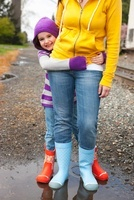 Mother and Daughter Wearing Rain Boots