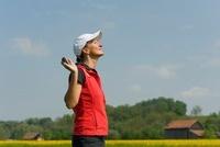 Woman with Golf Club Basking in Sun