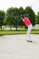 Woman in Sandpit on Golf Course