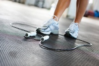 Woman with Jump Rope in Gym