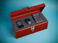 Cell Phone, Computer Mouse and Calculator in Toolbox
