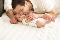 Father Kissing Infant Son