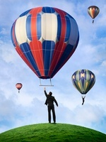 Business People Hanging On to Hot Air Balloons