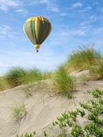 Hot Air Balloon Floating Over Sand Dunes, Ocean Beach, San F